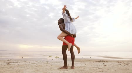 multiethnic : happy couple having fun on summer beach