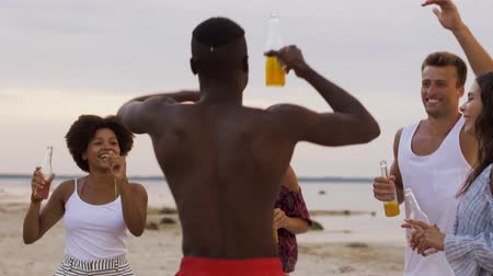 afro americana : happy friends dancing at summer beach party
