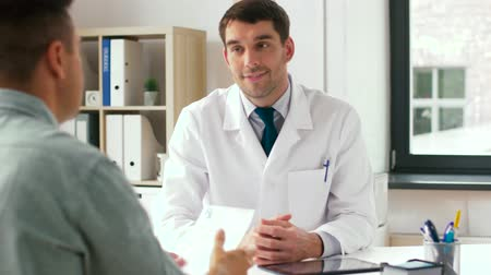 referral : doctor and patient with prescription at clinic
