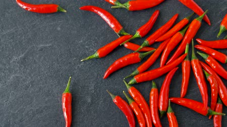 chili : red chili or cayenne pepper on stone surface