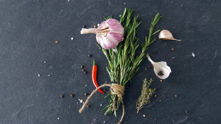 kakukkfű : rosemary, garlic and chili pepper on stone surface