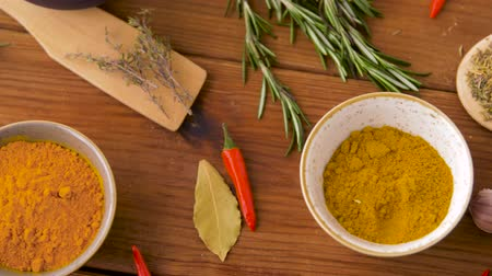 curcuma : different spices for cooking on wooden table