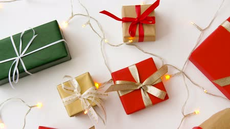 x mas : christmas gifts and garland on white background Stock Footage