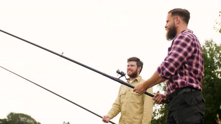 fisher : happy friends with fishing rods