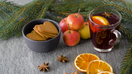 mulled wine : glass of hot mulled wine, cookies, apples and fir Stock Footage