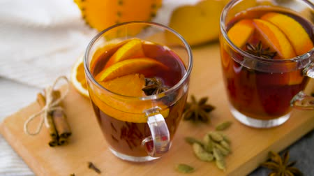 mulled wine : glasses of hot mulled wine with orange and spices