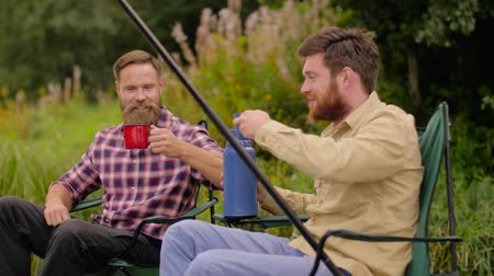 hot rod : friends fishing and drinking tea from thermos