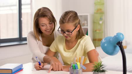 tables : mother and daughter doing homework together