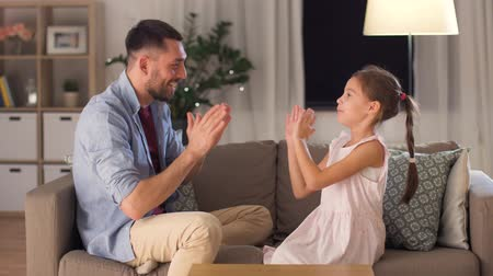 pre hispanic : father and daughter playing clapping game at home Stock Footage
