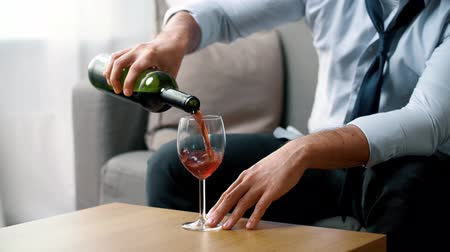 bad habits : alcoholic pouring red wine to glass at home Stock Footage