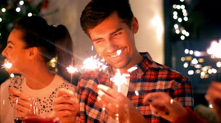 kutluyor : friends with sparklers at home christmas dinner
