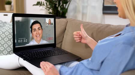 do widzenia : woman having video call on laptop computer at home