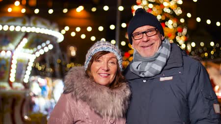 estonya : happy senior couple smiling at christmas market