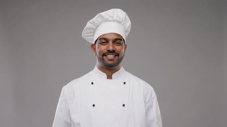 invite : happy male indian chef in toque Stock Footage