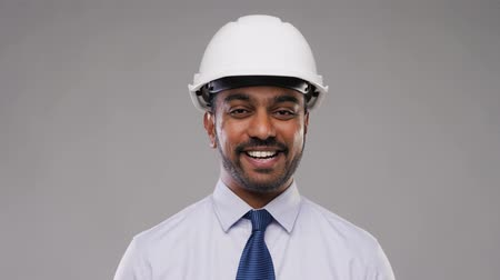 architectural protection : indian architect or businessman in helmet