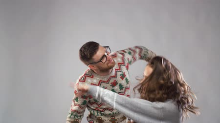 young animal : happy couple dancing at christmas party
