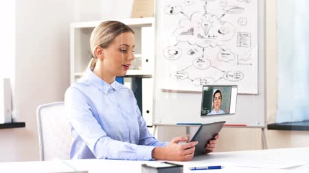 interactive table : businesswoman having video call on tablet computer Stock Footage