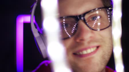 playlist : man in headphones over neon lights of night club Stock Footage