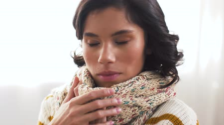 coughing : unhappy sick woman in scarf coughing at home Stock Footage
