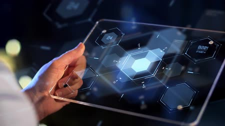 numerais : hand holding tablet pc with virtual projections Stock Footage