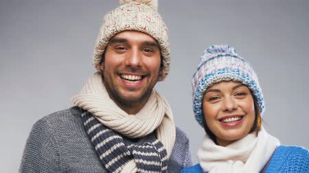knitted : happy couple in winter clothes
