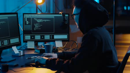 computer programmer : hacker using computer for cyber attack at night Stock Footage