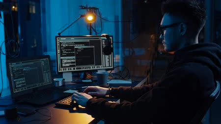 tela : hacker using computer for cyber attack at night Stock Footage