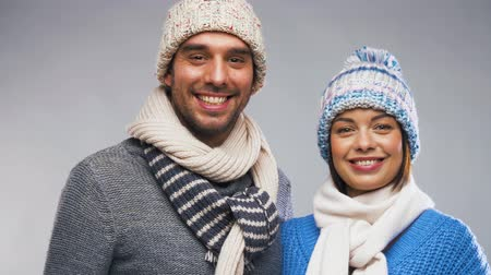 olá : happy couple in winter clothes waving hands