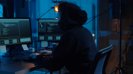 malware : hacker using computer for cyber attack at night Stock Footage
