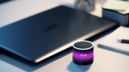 interactive table : glowing smart speaker with time on desk at office Stock Footage