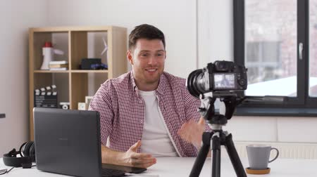 creator : male blogger with camera videoblogging at home Stock Footage