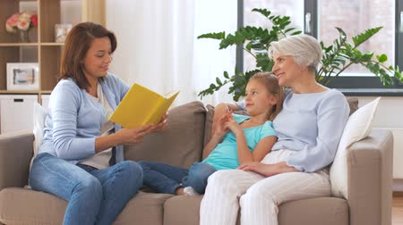 teen age : mother, daughter and grandmother reading book