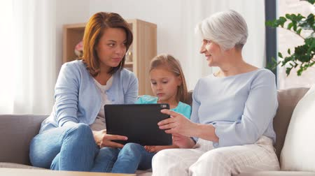 dziadkowie : mother, daughter and grandmother with tablet pc