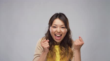 evet : happy asian woman celebrating success