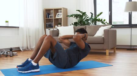 kroutit : indian man making abdominal exercises at home
