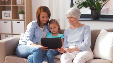 внучка : mother, daughter and grandmother with tablet pc