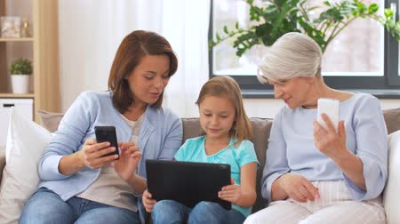 внучка : mother, daughter and grandmother with gadgets