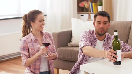 sitting floor : happy couple drinking red wine at home