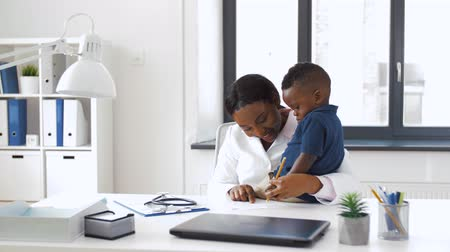 paediatrician : doctor or pediatrician with baby patient at clinic Stock Footage