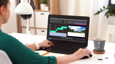 poczta : woman with video editor program on laptop at home