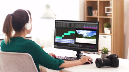 mixer : woman with video editor program on computer Stock Footage