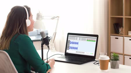 editor : woman with microphone recording podcast at studio Stock Footage