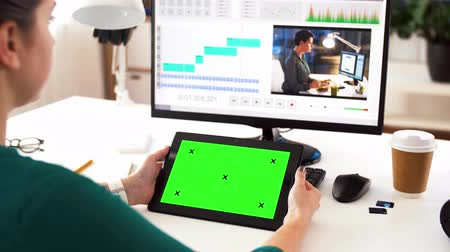 poczta : woman with green screen on tablet pc at home