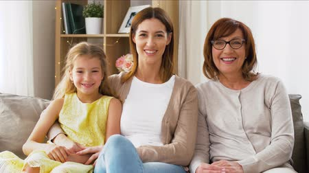 sitting room : portrait of mother, daughter and grandmother Stock Footage