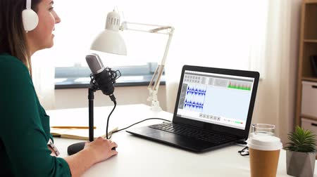 creator : woman with microphone recording podcast at studio Stock Footage