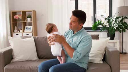 baby infant : middle aged father with baby daughter at home