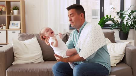 baby infant : middle aged father with crying baby at home Stock Footage