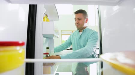frig : man taking juice from fridge at home kitchen Stock Footage