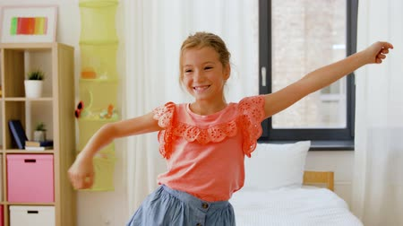 pré adolescente : happy little girl dancing in her room at home