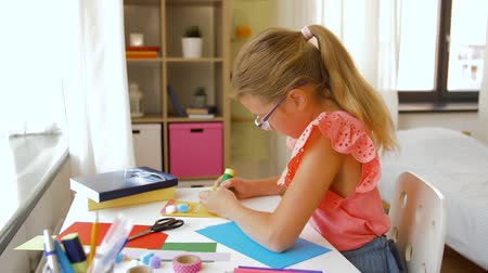 scrapbook : creative girl making greeting card at home Stock Footage